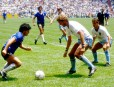 (L-R) Argentina's Diego Maradona takes on England's Terry Butcher and Kenny Sansom.