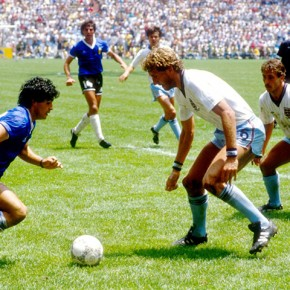 (L-R) Argentina's Diego Maradona takes on England's Terry Butcher and Kenny Sansom.