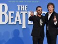 "British singer-songwriter Paul McCartney (R) and muscian Ringo Starr (L) of legendary rock-band The Beatles pose arriving on the carpet to attend a special screening of the film ""The Beatles Eight Days A Week: The Touring Years"" in London on September 15, 2016. / AFP PHOTO / Ben STANSALL"