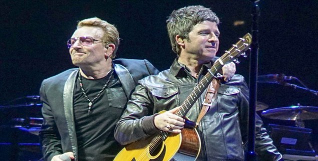 """PIC BY  Joe Ahorro/Geoff Robinson Photography 07976 880732.   Picture shows Noel Gallagher (2nd right) on stage with Bono from U2 at the O2 Arena in London on October 26th.Also pictured are Adam Clayton (right) and The Edge.  Oasis singer Noel Gallagher joined rock band U2 on stage at the O2 in London last night (Mon).  The star played his guitar and sang """"I Still Haven't Found What I'm Looking For"""" with the group on their second night at the O2 as part of their Innocence and Experience tour.  He also joined them in playing the Beatles classic All You Need Is Love.  U2 are playing 20 cities in the Europe and North America Innocence and Experience Tour, which finishes in November.  They started the England leg on Sunday and will play four more nights at the O2 before continuing to Glasgow, Belfast and Dublin.  The tour follows the recent release of its thirteenth studio album, Songs of Innocence."""
