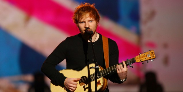 Ed Sheeran performs at the night that changed America: a Grammy salute to the Beatles, on Monday, Jan. 27, 2014, in Los Angeles. (Photo by Zach Cordner/Invision/AP)