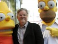 "FILE - In this Feb. 14, 2012 file photo, Matt Groening, creator of the animated series ""The Simpsons,"" poses with his character creations Bart Simpson, left, and Homer Simpson after he received a star on the Hollywood Walk of Fame in Los Angeles. One of the best-kept secrets in television history has been revealed, with Groening pointing to Springfield, Ore. as the inspiration for the animated hometown of Homer and family. (AP Photo/Chris Pizzello, File)"